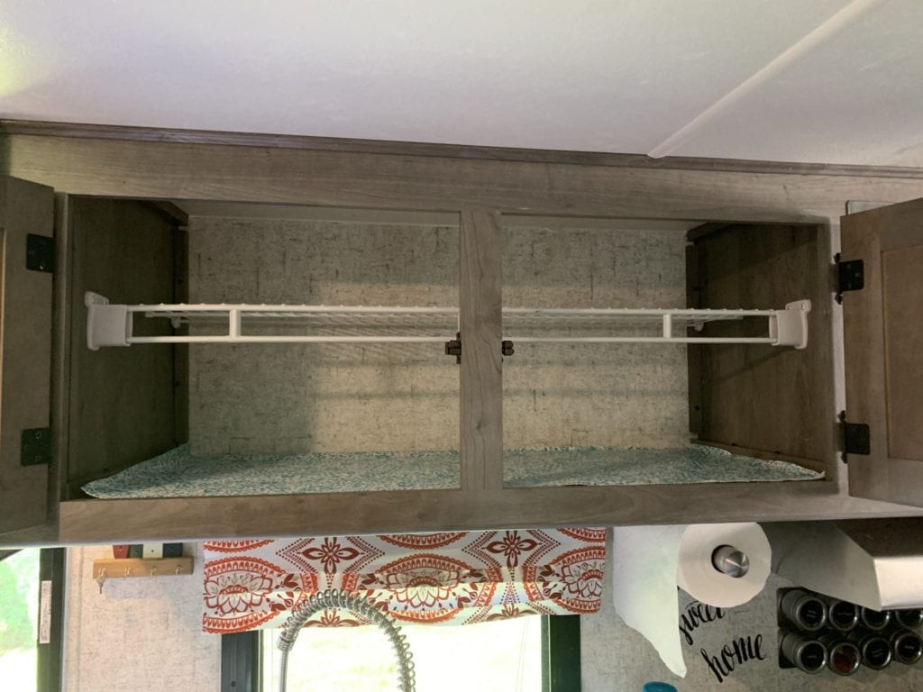 Inside of Kitchen Cabinet With Shelf Installed